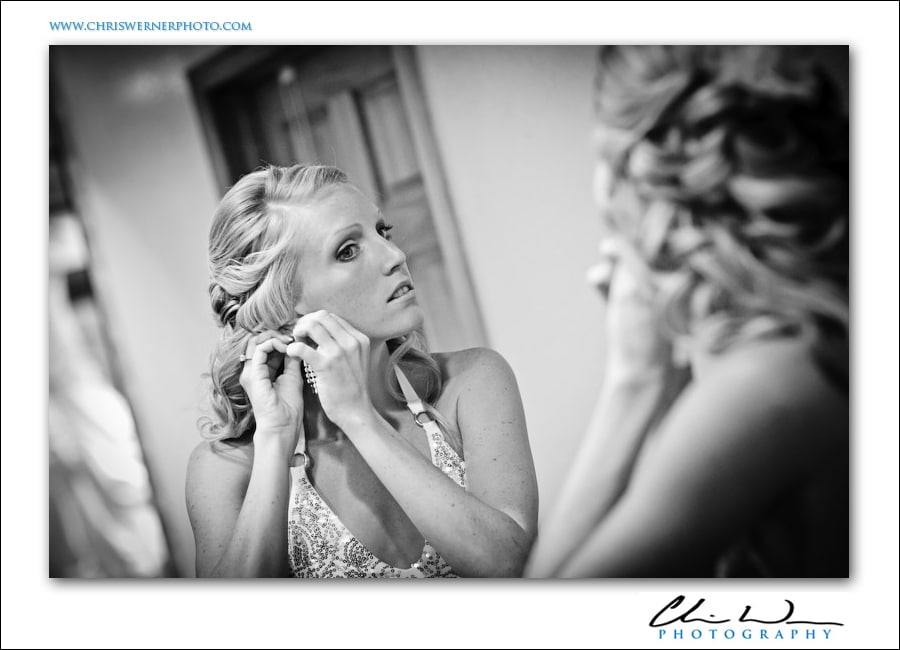 Bride putting on her earrings, Wild Basin Lodge Wedding.