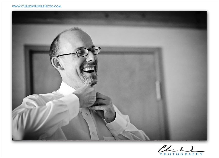 Groom buttoning his shirt, Yosemite Wedding Photographers.