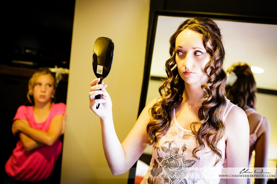 Photograph of a bride looking in the mirror, Squaw Valley PlumpJack wedding photos.