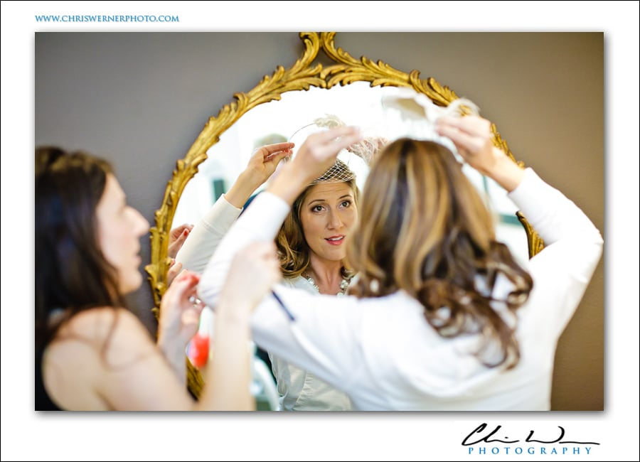 Bride looking in the mirror before her wedding in San Francisco.