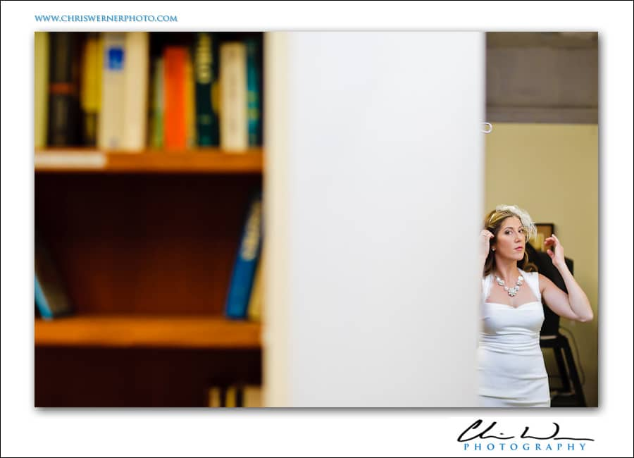 Bride looking in the mirror at St. Johns Church in San Francisco.